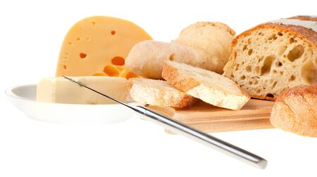 butter knife: piece of butter, cheese, bread and a knife