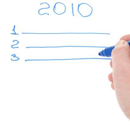 mans hand holding a blue felt-tip on form of plan photo