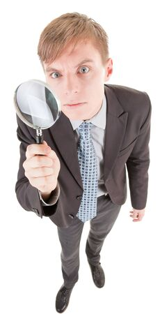 portrait of business man  with magnifier in hand Stock Photo - 6631263