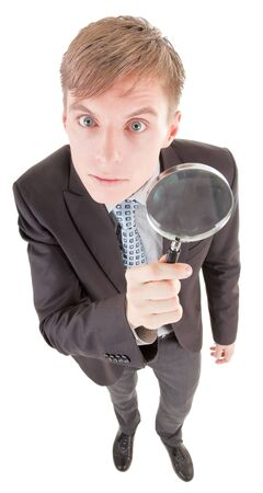 portrait of business man  with magnifier in hand