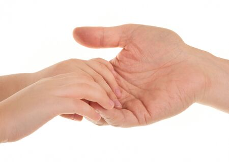a handshake, young (child) hands hug a adult hand photo