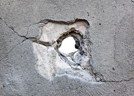 hole in the concrete, the conceptual background Stock Photo - 6901119