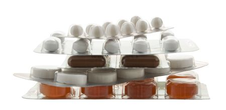 handful of packing different pills on white Stock Photo - 6901111