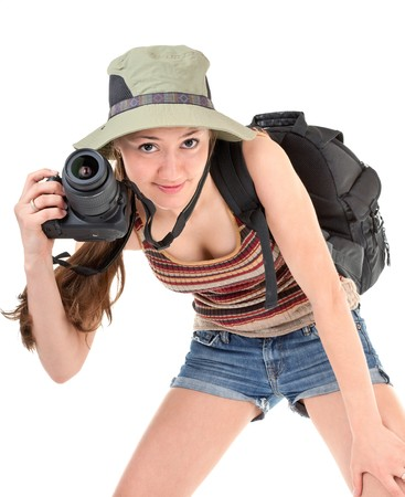 young girl tourist with camera on white photo