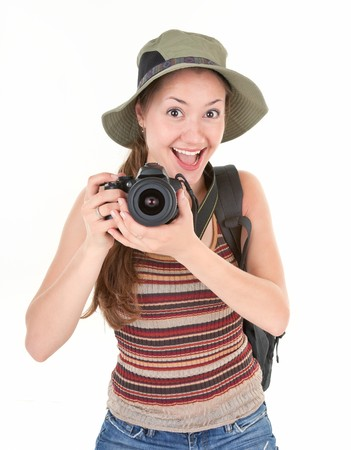 young girl tourist with camera on white