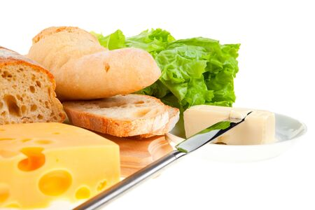 butter knife: piece of butter, fresh bread and a knife