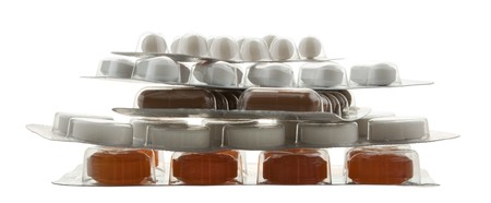 handful of packing different pills on white Stock Photo - 7039830