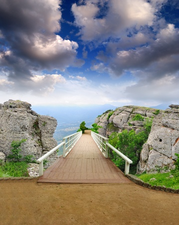 scenic park wooden bridge with magical view from the mountains to the valley Stock Photo - 8659171