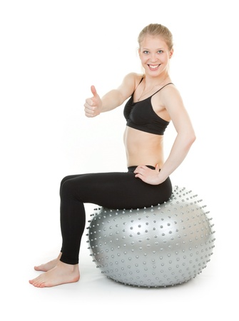 athletic girl with a big silver ball photo