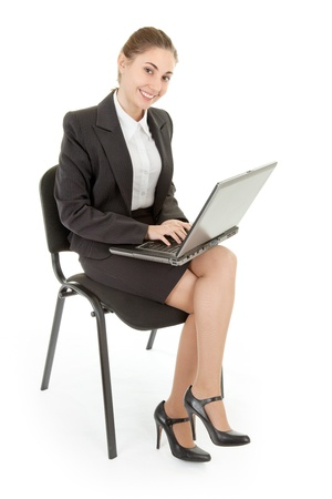 business woman  in spectacles and laptop on white photo