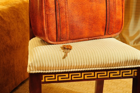 hotel background with a chair, a suitcase and key photo