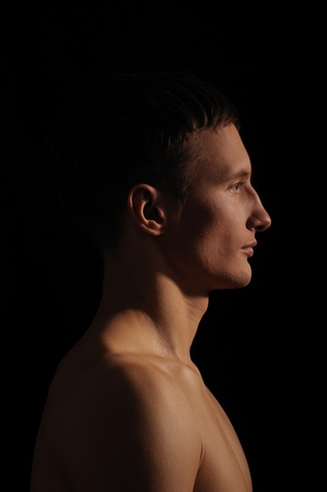 young man - sportsman with a bare torso Stock Photo - 8892903