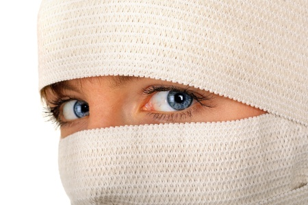 covering the face: Eyes of great beauty and bandages on  head