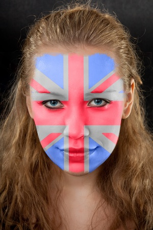 british girl: portrait of a young girl on black background