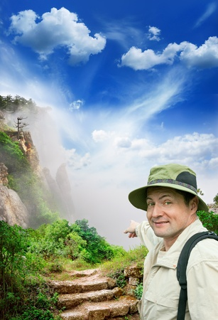 brisk tourist shows the direction on a country road Stock Photo - 9485196