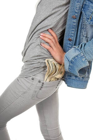 hooligan looking girl with the money on a white background photo