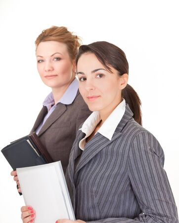 Portrait of two business women on white background