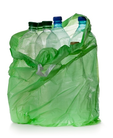 simple plastic bottles in a garbage bag on a white background.