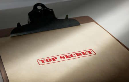 marked top secret on a pile of documents photo