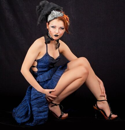portrait of a girl in a blue dress on a black background photo