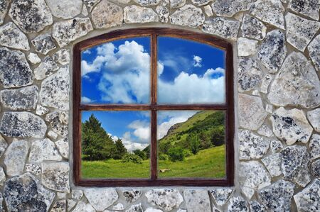 stone wall with a window as an background Stock Photo