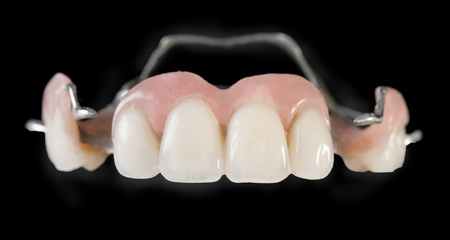 dentition: dental implants, plastic on a black background