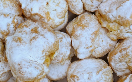 eclairs, covered with vanilla icing sugar as a background Stock Photo - 10507815