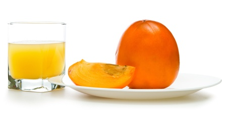 fruit persimmons and  glass of juice