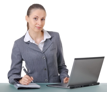clerical: office manager at the desk with a laptop Stock Photo