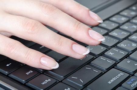 womens fingers over the keyboard laptop photo