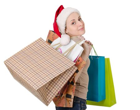 girl in the hat of Santa Claus is shopping photo
