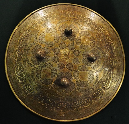 Medieval eastern shield of brass. Collection of National Museum Bakhchisarai Palace, commercial photography not limited.