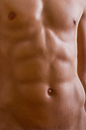 belly naked male body (an athlete) photo