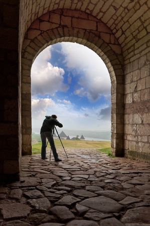 figure of the photographer in the national Ukrainian Reserve Hotyn Castle photo