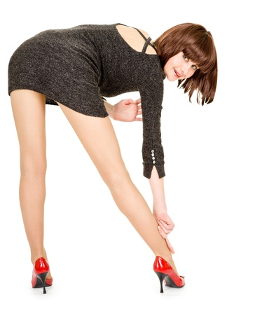 fashionista in a short dress in a tilted position on a white background photo