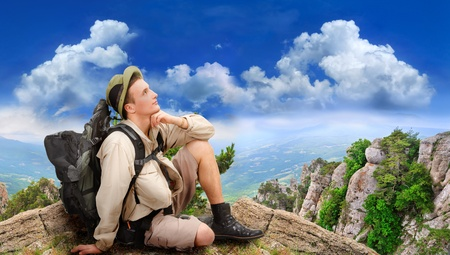 young man dressed in a tourist on a nature background photo