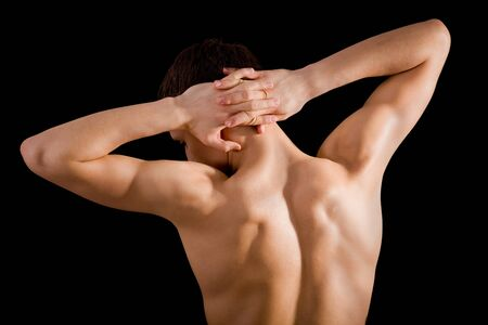 muscular body: bare back and shoulders athlete on a black background
