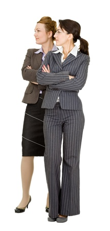 working attire: portrait of two women in office clothes on a white background