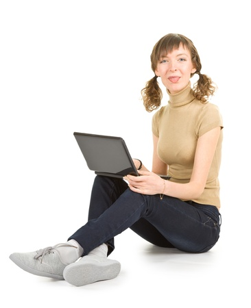 young girl with laptop on white background (with shadow and clipping path) Stock Photo - 10923172