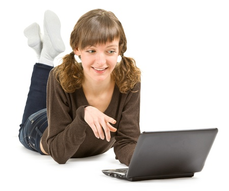 young girl with laptop on white background with shadow and clipping path Stock Photo - 10923106