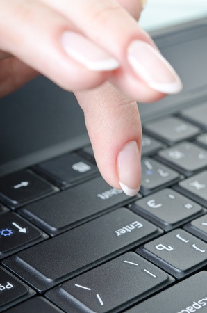 womens fingers over the keyboard laptop