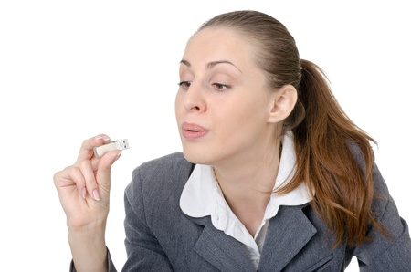 office manager, a woman closely examining USB flash drive Stock Photo - 11180907