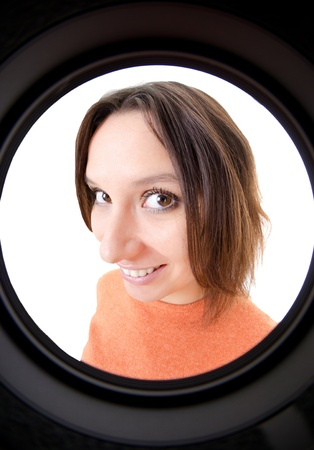 woman looking through the peephole Stockfoto