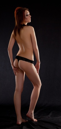 naked girl on a black background (silhouette) photo