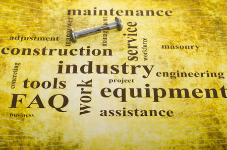 bolt and nut on the artistic background of the relevant words Stock Photo - 11181075
