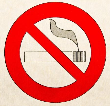 A warning sign no smoking on broun paper photo