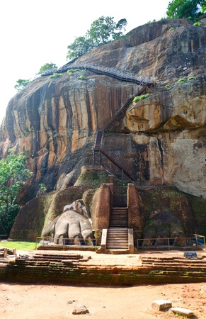 remnants of a stone lion at the entrance and stairs to the palace of the King on Sigiriya ( Lions rock ) in the central  Sri Lanka photo