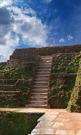 Sigiriya ( Lions rock ) is a large stone and ancient palace ruin in the central  Sri Lanka ( Ceylon ) photo