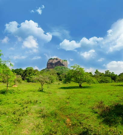 Sigiriya ( Lion's rock ) is a large stone and ancient palace ruin in the central  Sri Lanka. Panorama of the three vertical frames and horizontal one. photo