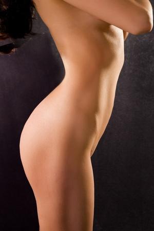 naked female body on a black background photo